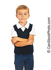 School boy with arms folded