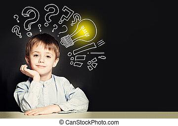 School boy with lightbulb on background. Idea concept