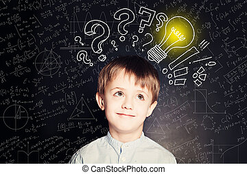 School boy with lightbulb on background. Science idea concept wi