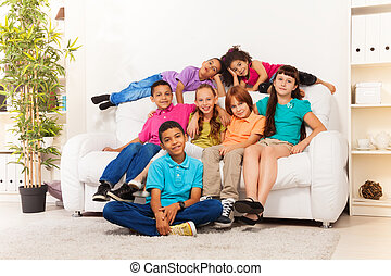 School boys and girls at home together