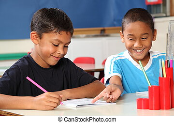 School boys learning in class - Cheerful young primary...