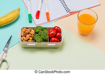 School breakfast on desk with books and pen on board background