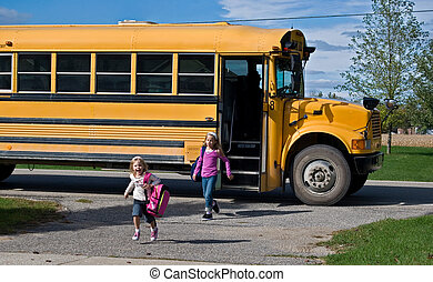 School Bus - Little girls getting off a school bus.