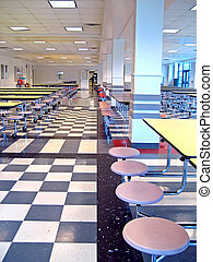 School Cafeteria - Clean school cafeteria with many empty...