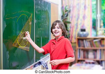 School child at math class