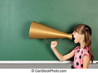 school child shouting magaphone near blank school blackboard, copy space
