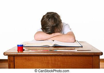 School child with head in hands
