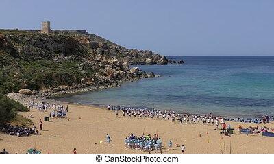 School children activities on beach - School children in...