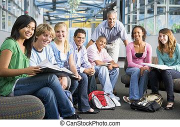 School children and their teacher in a high school class