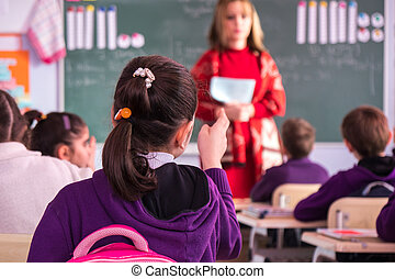 school children are participating actively in class. Education