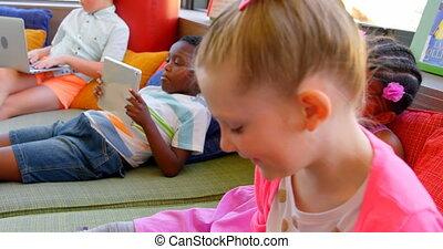 School children having fun in the school library 4k