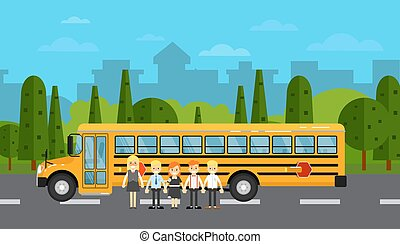 School children near school bus on highway