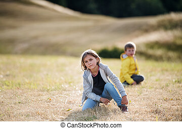 School children on field trip in nature, looking at camera.