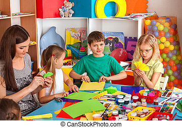 School children with scissors in kids hands cutting paper ....