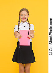 School club after classes. Study foreign language. Essay for homework. KId girl student likes to study. Study literature. Private lesson. Adorable child schoolgirl hold copybook. Formal education