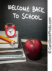 School concept - Apple on books and welcome back to school...