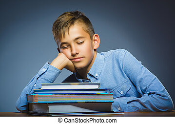 school concept. Closeup portrait boy asleep on pile of books