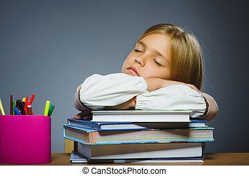 school concept. Closeup portrait girl asleep on pile of books