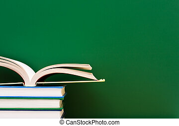 School Days - Stack of books one open in front of the...