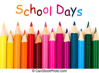 School Days - Colorful pencil crayons on a white background,...