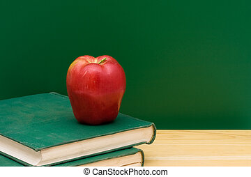 School Days - Two old books with an apple in front of the...