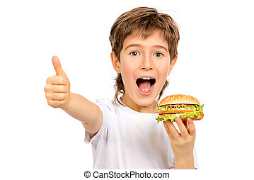 school dinner - Happy nine year old boy eating burger with...