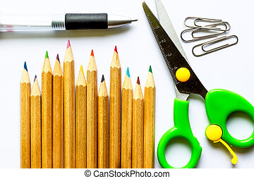 color pencils and school suppiles on white paper