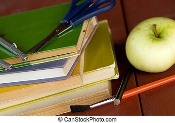 Pile of books, apple and school equipment. Education concept, back to school.