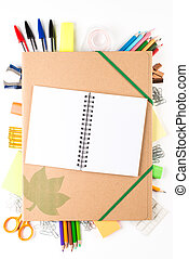 School equipment with notebook on white background
