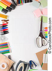 School equipment with paper on white background