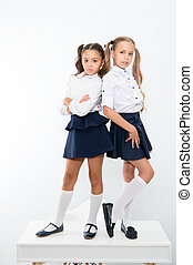 school fashion. kid fashion for little girls in school uniform. little girls isolated on white.
