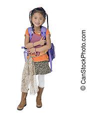 School Girl - A young asian school girl ready for school.