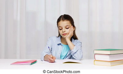 school girl hand writing math task to notepad - education,...