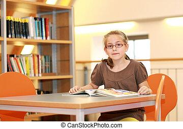 School girl in library