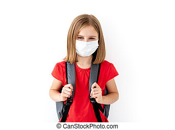 School girl in medical face mask