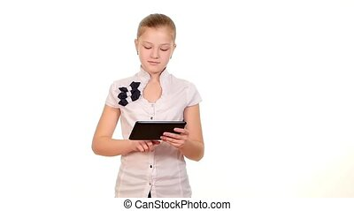 School girl looking for something using tablet computer, on white background, slow motion
