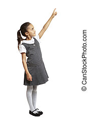 School girl pointing up smiling