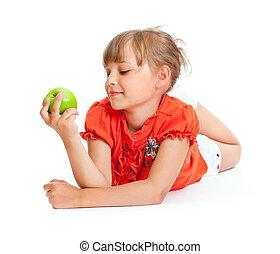 School girl portrait eating green apple isolated