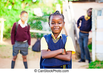 school girl - pretty young african girl standing proud in...