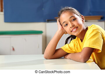 School girl relax at classroom desk - Young school girl, 10,...