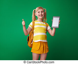 school girl showing thumbs up and and tablet PC blank screen