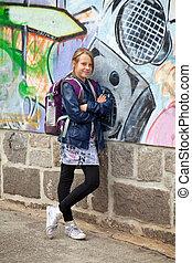 school girl on wall