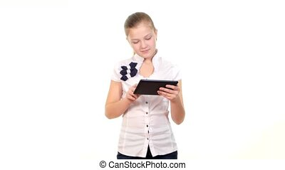 School girl using tablet computer and becomes happy finding something, on white background