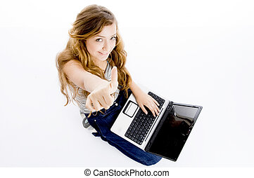 school girl with laptop and thumbs up on an isolated...