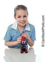 School girl with microscope