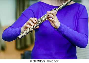 School girl with transversal flute in music school
