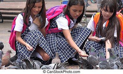 School Girls Feeding Pigeons
