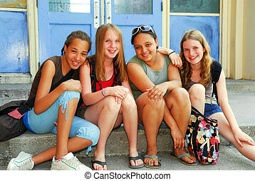School girls - Portrait of a group of young smiling school...
