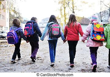 school girls running away - happy school girls running...