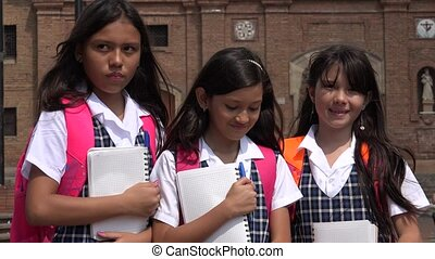 School Girls With Notebooks